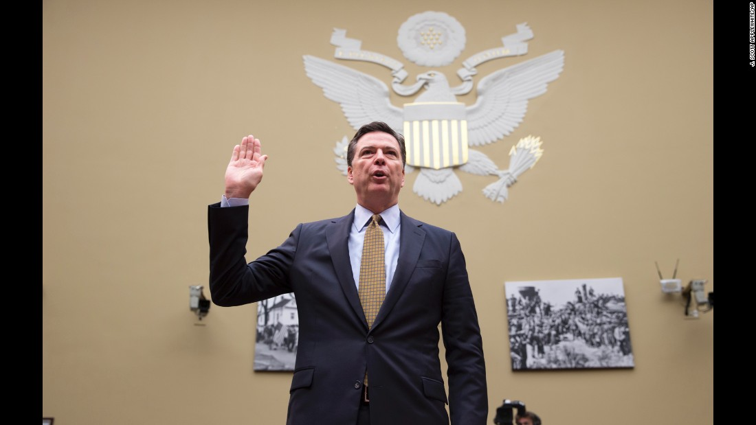 "FBI Director James Comey is sworn in before <a href=""http://www.cnn.com/2016/07/07/politics/james-comey-hillary-clinton-email-hearing/"" target=""_blank"">testifying to the House Oversight and Government Reform Committee</a> on Thursday, July 7. Comey defended his handling of <a href=""http://www.cnn.com/2016/07/05/politics/fbi-director-doesnt-recommend-charges-against-hillary-clinton/"" target=""_blank"">the Hillary Clinton e-mail investigation,</a> which found that Clinton and her aides were ""extremely careless"" in the handling of classified information during her time as secretary of state. GOP lawmakers were frustrated, however, over Comey's decision not to seek charges against the Democrats' presumptive presidential nominee."
