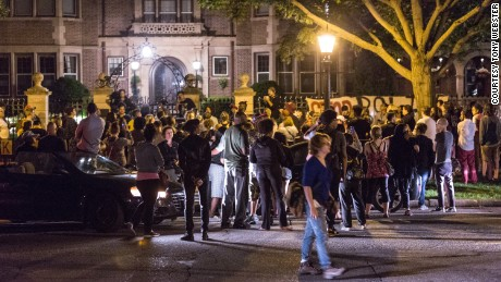 A crowd of community members gather outside the Governor's Residence in Saint Paul, Minnesota, in the 2 a.m. hour on July 7, 2016, following the police shooting of Philando Castile in Falcon Heights, Minnesota, by a St. Anthony Police officer.