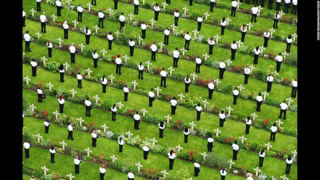 "Young people lay wreaths in Thiepval, France, to mark the 100th anniversary of the <a href=""http://www.cnn.com/2016/07/01/europe/gallery/battle-of-the-somme-100th-anniversary/index.html"" target=""_blank"">Battle of the Somme </a>on Friday, July 1. French and British armies fought the Germans during the battle, which took place during World War I."