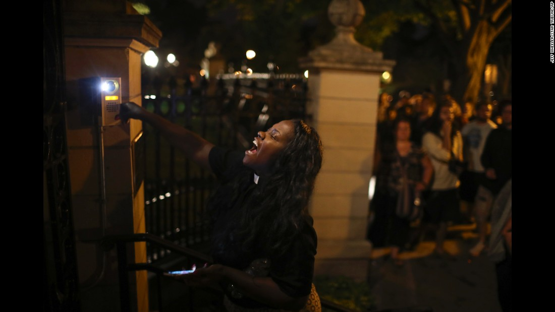 "A woman rings the doorbell at the gate of the Minnesota governor's home following the shooting death of Philando Castile on Wednesday, July 6. Castile, 32, was fatally shot by police during a traffic stop in Falcon Heights, Minnesota. His fiancee, Diamond Reynolds, <a href=""http://www.cnn.com/2016/07/07/us/falcon-heights-shooting-minnesota/"" target=""_blank"">live-streamed the aftermath</a> on Facebook. The shooting is being investigated."