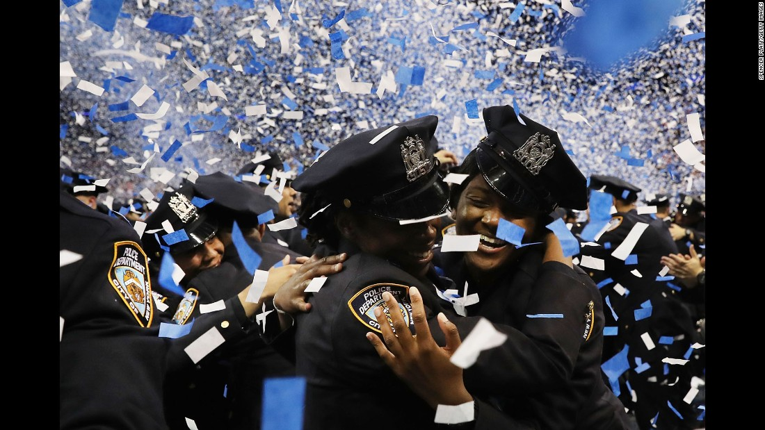 New members of the New York Police Department celebrate after their swearing-in ceremony on Friday, July 1.