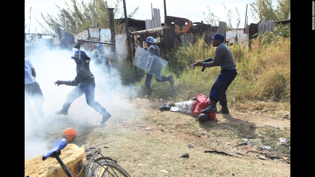 Police in Harare, Zimbabwe, clash with rioters on Monday, July 4. Police used tear gas and water cannons against taxi and minibus drivers who were protesting what they called police harassment.