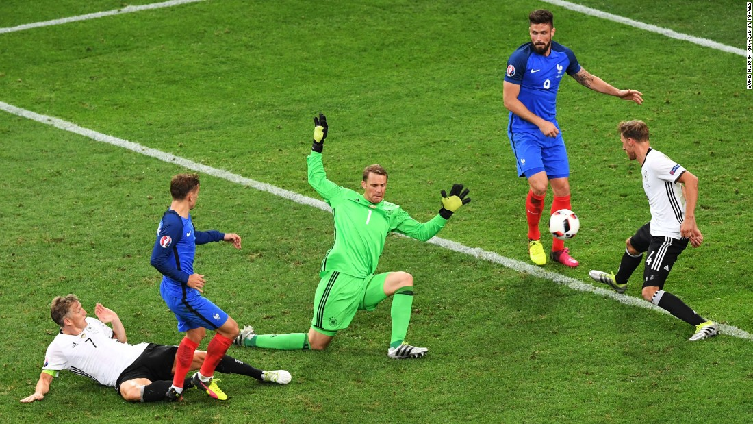 Antoine Griezmann, second from left, scores the second goal of the match. Griezmann had both of France's goals, and he leads the tournament with six goals scored.