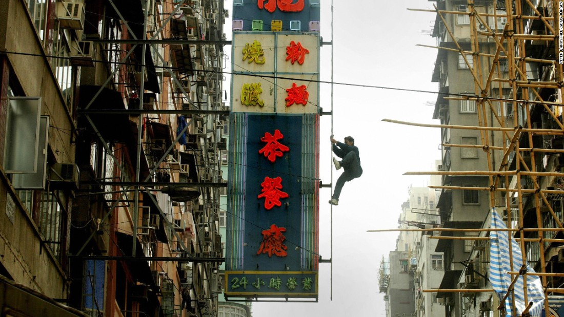 Hong Kong's neon lights flourished in the post-war decades, layers upon layers of them lining the city's thoroughfares and roads. Today they're disappearing fast, being replaced by more energy-efficient LED lights. Veteran bamboo scaffolders are able to deftly navigate these heights.
