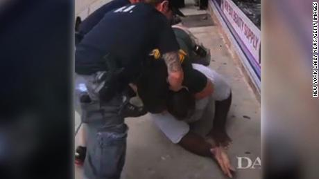 An NYPD officer puts Eric Garner in a prohibited chokehold.