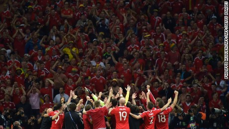 Wales players celebrate their team's 3-1 win over Belgium at Euro 2016.