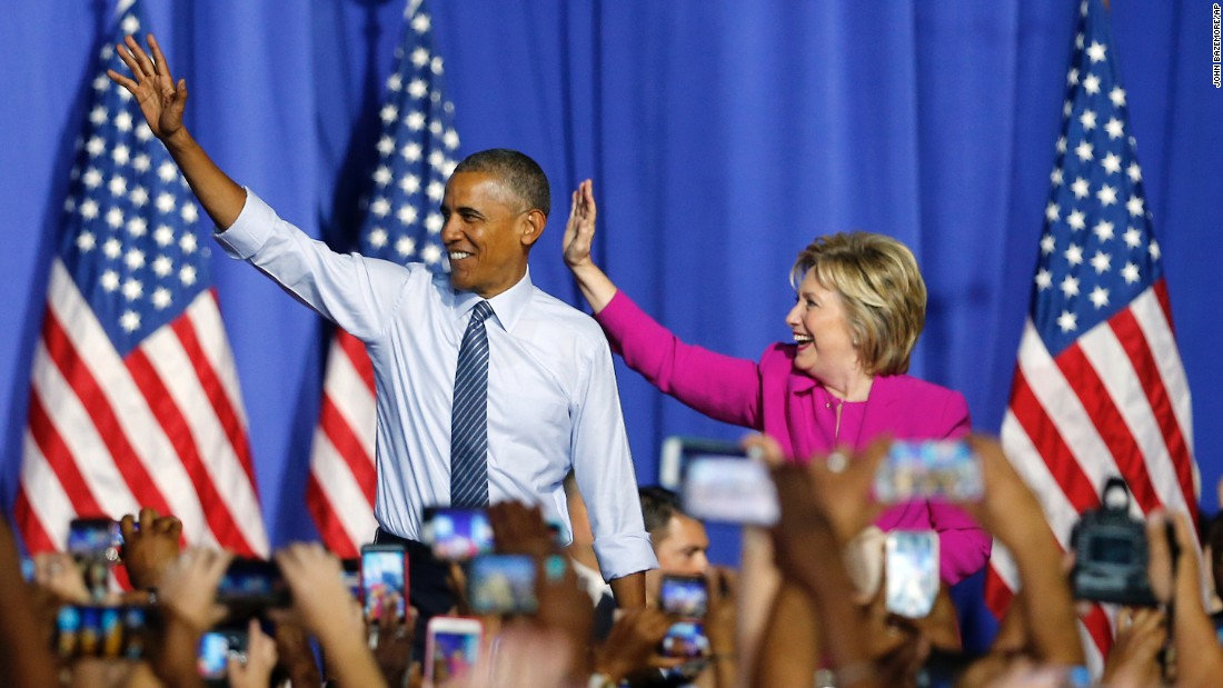 "U.S. President Barack Obama and Democratic presidential candidate Hillary Clinton <a href=""http://www.cnn.com/2016/07/05/politics/obama-clinton-campaign-charlotte/"" target=""_blank"">attend a campaign rally for her</a> in Charlotte, North Carolina, on Tuesday, July 5. Obama said he became a loyal Clinton convert years ago and that their Democratic primary fight from 2008 is all in the past."