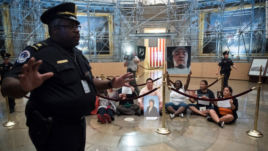 Police clear tourists and media from the U.S. Capitol Rotunda as protesters stage a sit-in over gun violence on Tuesday, July 5.