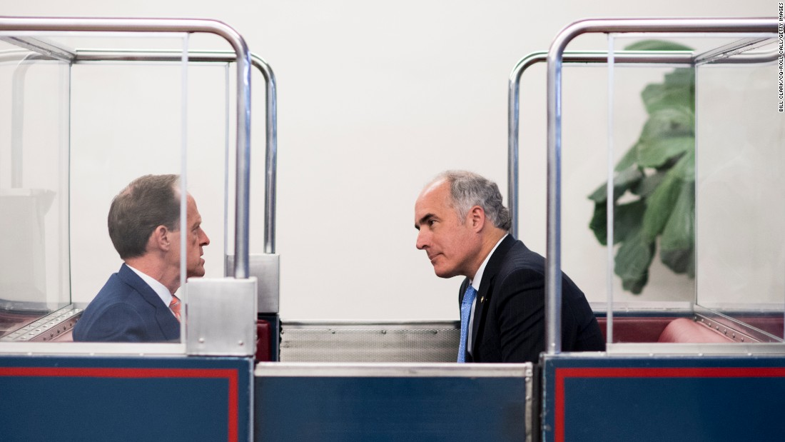 U.S. Sens. Pat Toomey, left, and Bob Casey Jr. talk on the U.S. Capitol's subway system on Wednesday, July 6.