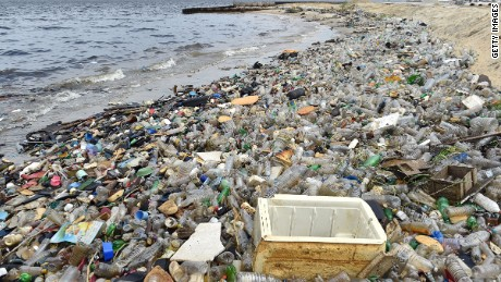 Plastic bottles and other waste cover a beach after being washed ashore near the port of Abidjan on August 5, 2015 despite efforts by the government to promote a greener economy by banning plastic bags. AFP PHOTO / ISSOUF SANOGO        (Photo credit should read ISSOUF SANOGO/AFP/Getty Images)