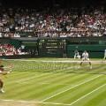 Federer vs Raonic wimbledon semifinal action shot