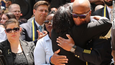 People line up to hug police officers in Dallas