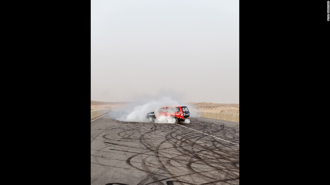 "An SUV slides on a stretch of asphalt in Umm al-Quwain, one of the emirates in the United Arab Emirates. Photographer Peter Garritano documented the youth culture of ""hajwalah,"" or drifting vehicles for sport."