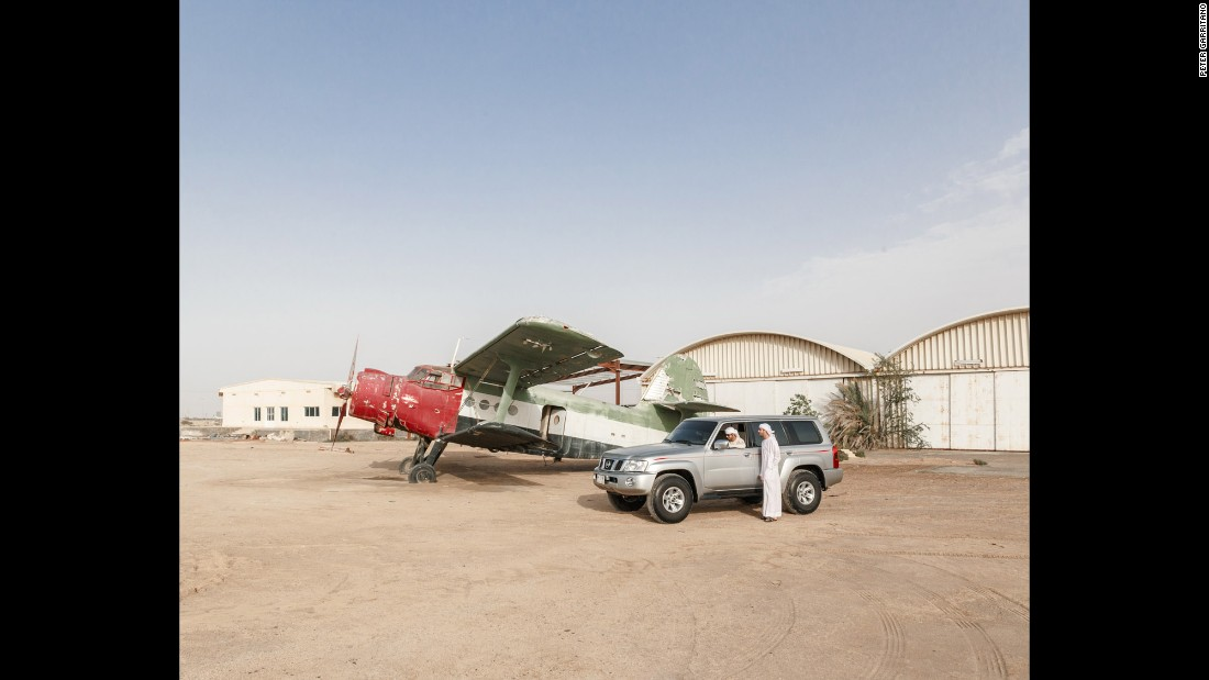 Two brothers stop at an old airfield near a drifting meet in Umm al-Quwain.