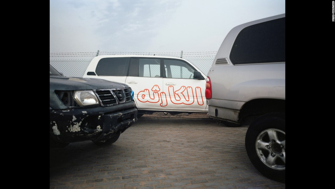 "Cars line up at a drifting meet. The decal pictured here reads ""disaster"" in Arabic. It is also the name of a crew of drivers."