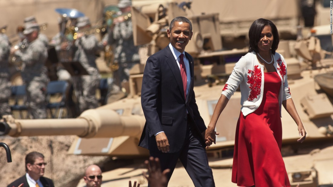 U.S. President Barack Obama and first lady Michelle Obama walk on stage at Fort Stewart Army post on April 27, 2012, in Hinesville, Georgia. This was Obama's first trip to Fort Stewart, where he met with soldiers and their families.
