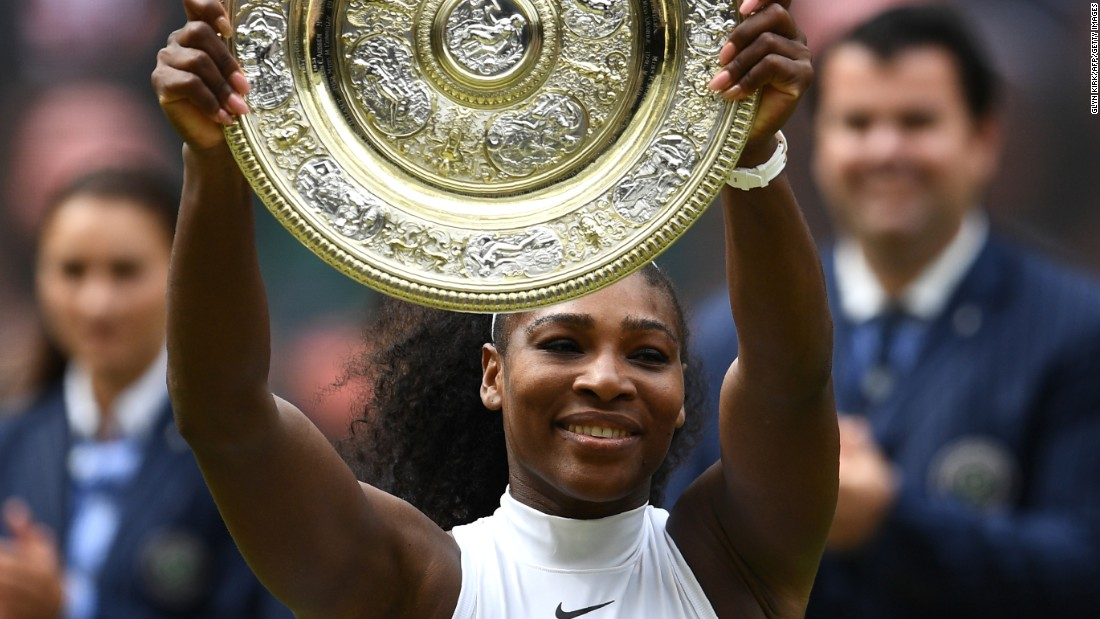 Serena Williams poses with the Venus Rosewater Dish after her women's singles final victory over Germany's Angelique Kerber.