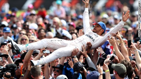 Lewis Hamilton celebrates his British GP win by crowdsurfing with the fans at Silverstone.