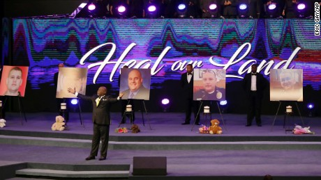 Bishop T.D. Jakes prays during the church service.