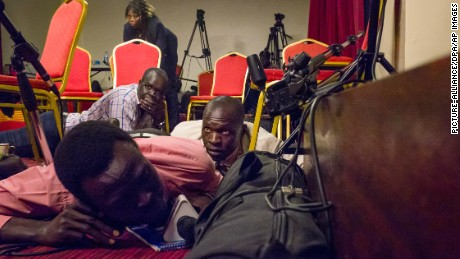 Journalists lie on the floor of a press room  in the presidential palace after shots on the building shortly before the start of a planned press conference with the president of South Sudan, Salva Kiir Mayardit, and his deputy, Riek Machar, on the occasion of the 5th independence day anniversary in Juba, South Sudan, 8 July 2016. Photo by: dpa/picture-alliance/dpa/AP Images