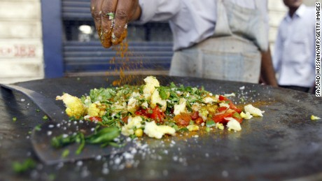 An Indian food vendor prepares a dish at his roadside stall in Mumbai, 11 March 2007. Mumbai, India's financial capital, is renowned for its vast array of street food, from Persian influenced Parsee snacks, to Goan fish curry, the city's streets are alive with affordable, tasty meals and snacks.