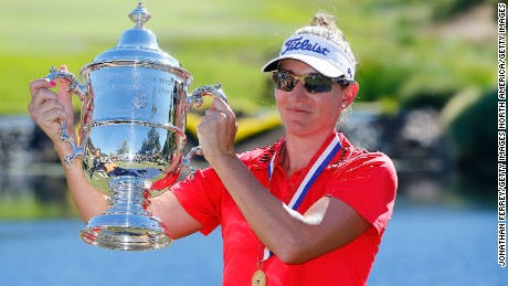 Brittany Lang poses with the trophy after defeating Anna Nordqvist to win the U.S. Women's Open.
