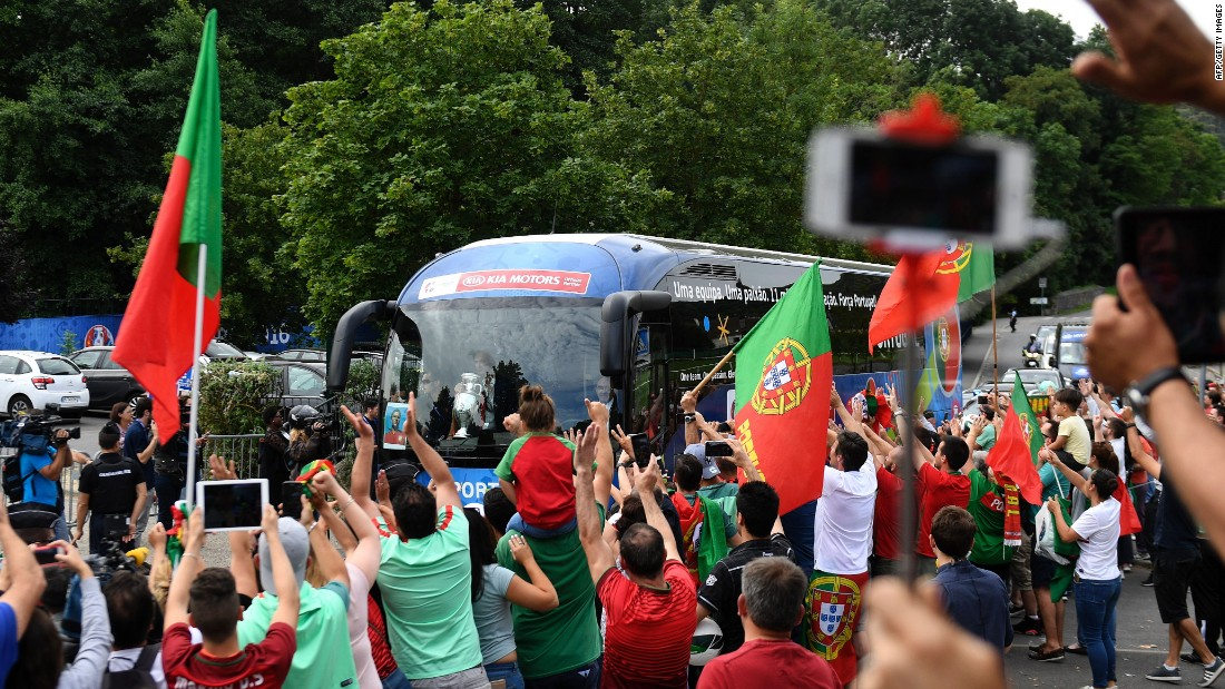 After celebrating long into the night after beating France in the Euro 2016 final, exultant Portugal fans gathered around the team bus as the players left their base camp in Marcoussis to return home.