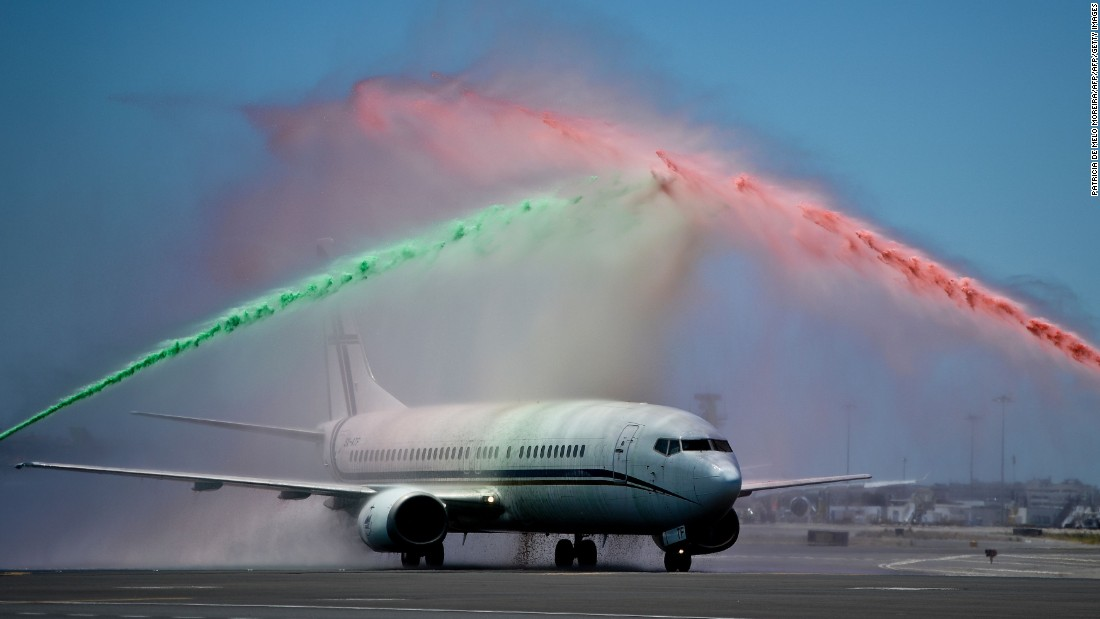 As their plane touched down in Lisbon, the players were welcomed back by an airport firefighters' unit spraying water over the aircraft in the national colors.