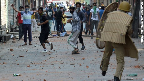 Police clash with Kashmiri protesters Monday in Srinagar.