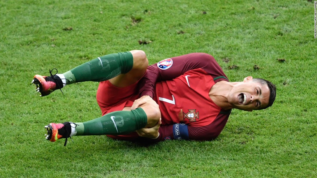 "Cristiano Ronaldo reacts after a tackle by Dimitri Payet during the Euro 2016 championship match between Portugal and France at the Stade de France in Paris on Sunday, July 10. <a href=""http://edition.cnn.com/2016/07/10/football/france-portugal-euro-2016-final/index.html"" target=""_blank"">Portugal defeated France</a> 1-0, despite Ronaldo being forced to leave the game with a knee injury."