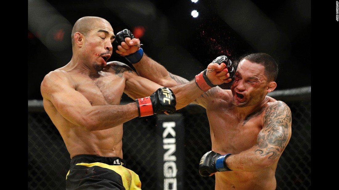 Jose Aldo, left, and Frankie Edgar trade blows during their featherweight championship mixed martial arts bout at UFC 200 on Saturday, July 9.