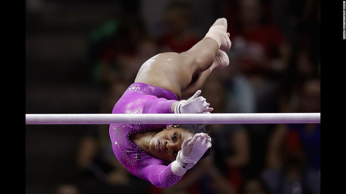 Gabrielle Douglas competes on the uneven bars during Day 1 of the U.S. women's gymnastic team trials in San Jose, California, on Friday, July 8.