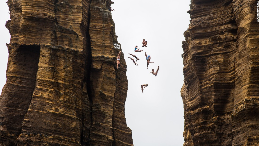 Todor Spazov, Gary Hunt, Kyle Mitrione, Helena Merten, Steven LoBue, Ginger Huber, Andy Jones, Rachelle Simpson and Lysanne Richard jump off a 72-foot (22 meter) rock monolith prior to the third stop of the Red Bull Cliff Diving World Series in Portugal on Thursday, July 7.