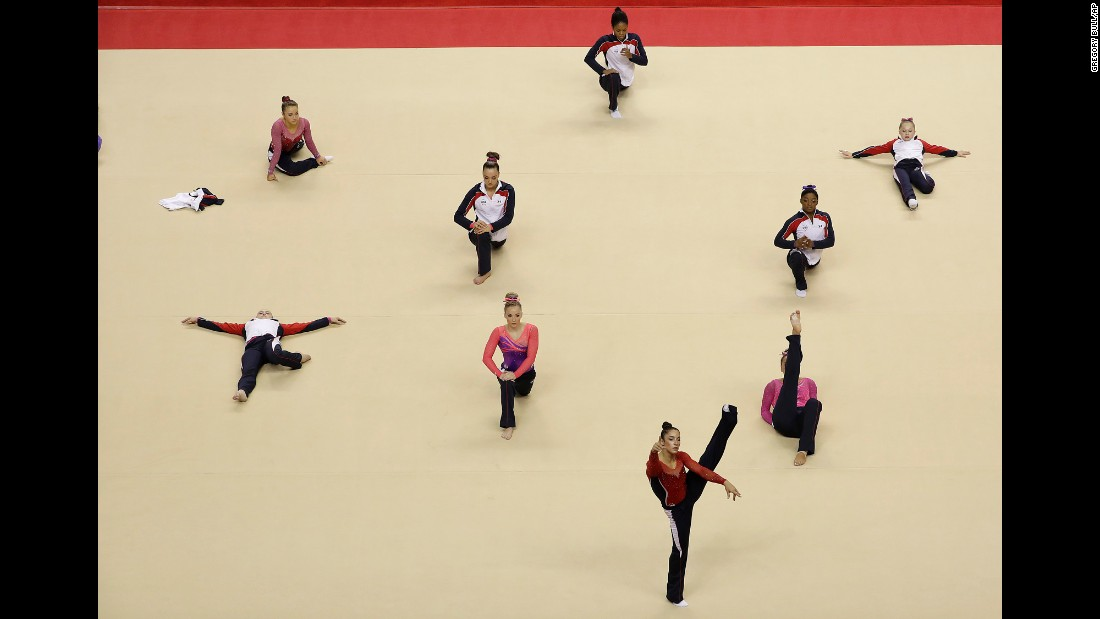 Competitors warm up before the women's U.S. Olympic gymnastics trials on Friday, July 8.