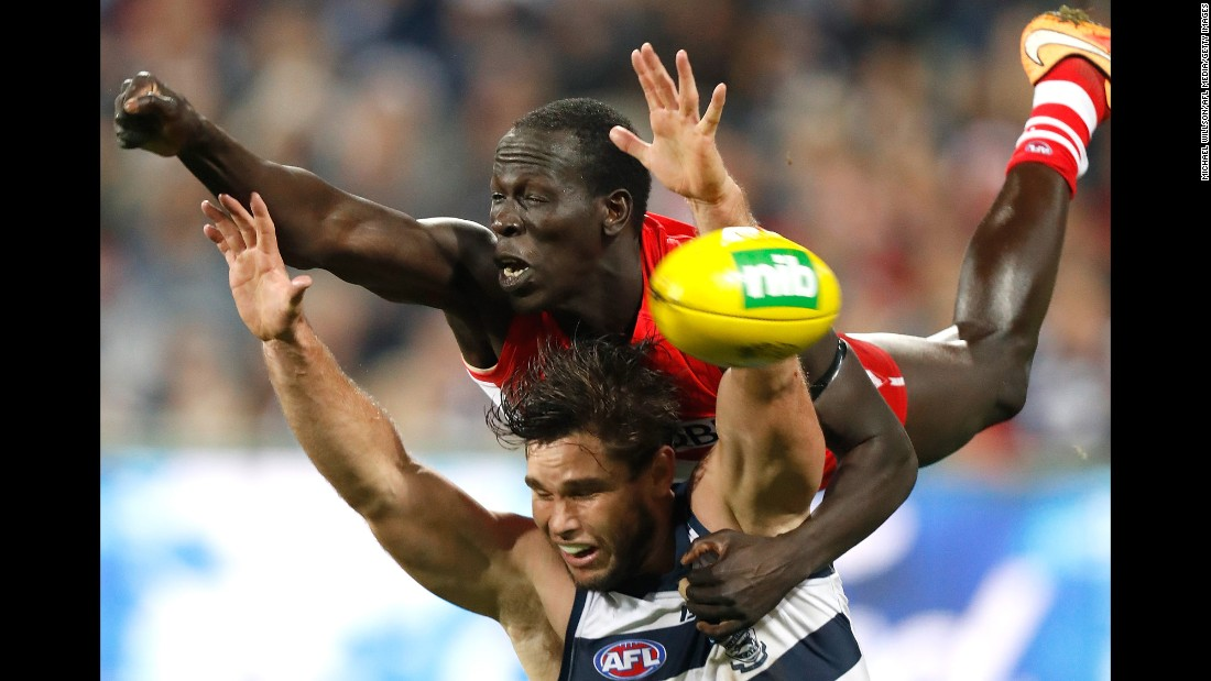 Aliir Aliir, top, and Tom Hawkins compete for the ball during the 2016 AFL Round 16 match between the Sydney Swans and the Geelong Cats on Friday, July 8.