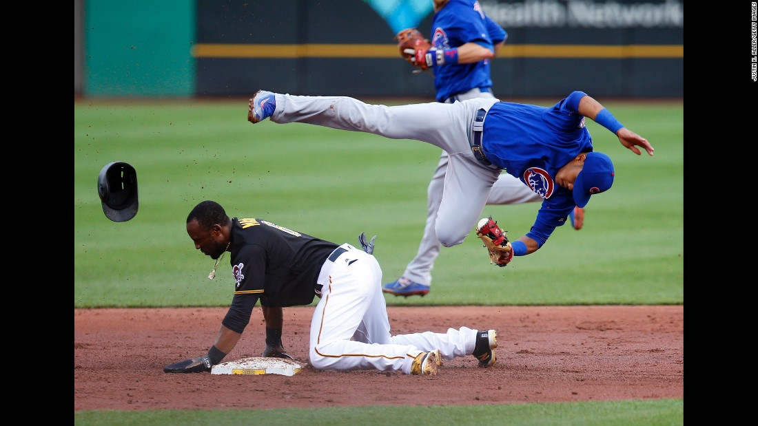 Starling Marte of the Pittsburgh Pirates breaks up the double play against Addison Russell of the Chicago Cubs during the second inning on Friday, July 8.