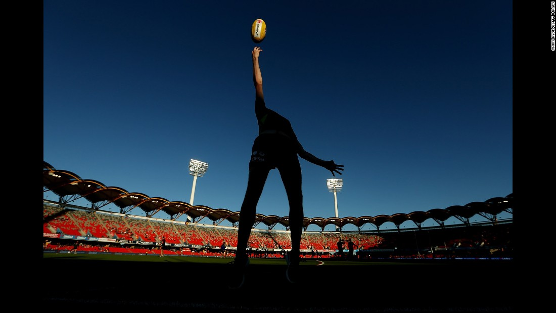 An umpire throws the ball before the round 16 AFL match between the Gold Coast Suns and the Brisbane Lions on Saturday, July 9.