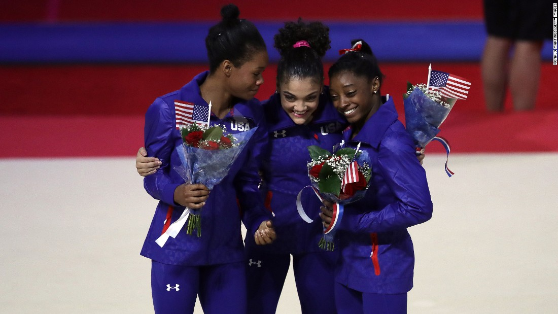 Gabrielle Douglas, left, Lauren Hernandez, and Simone Biles hug after Day 2 of the U.S. women's gymnastic team trials on Sunday, July 10. The trio were named to represent Team USA at the upcoming Olympic Games in Brazil, along with Aly Raisman and Madison Kocian.