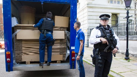 A moving van loaded with cardboard boxes is inspected by police before entering Downing Street on July 12, 2016 in London, England.
