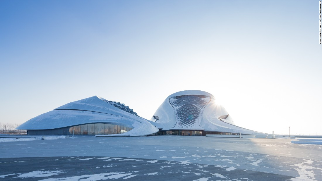 Made of white aluminum panels and glass pyramids, the opera house references the snow and ice of Harbin's sub-zero climate.