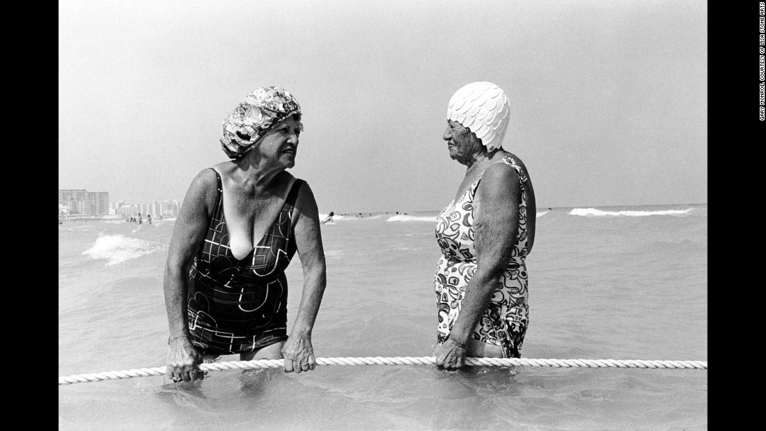 "Women hold a rope at the 10th Street beach in Florida in 1980. Leica camera in hand, <a href=""http://www.garymonroe.net/"" target=""_blank"">Gary Monroe</a> spent about a decade photographing life in South Beach. ""The camera was seen very differently then,"" he said. ""Everything was open to me, and I was welcomed to photograph."""