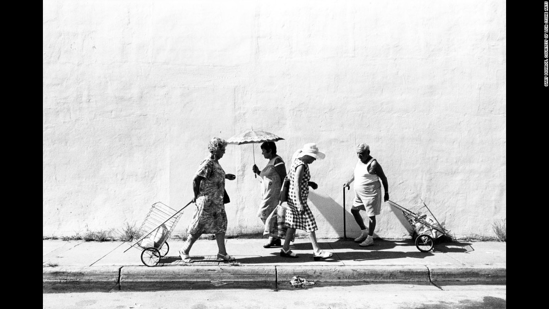 "People walk along Sixth Street, off Washington Avenue, in 1978. The South Beach the photographer shows us -- from 1977 through 1986 -- is a much different place than the one we know today. Monroe's images take us into the lives of the elderly Jewish community at the time, many of whom were survivors of the Holocaust and Czarist pogroms -- organized massacres of Jewish people. ""I didn't work with an agenda,"" Monroe said. ""I was giving form to my intuitions, making photographs on a deep breath and a prayer, so to speak."""
