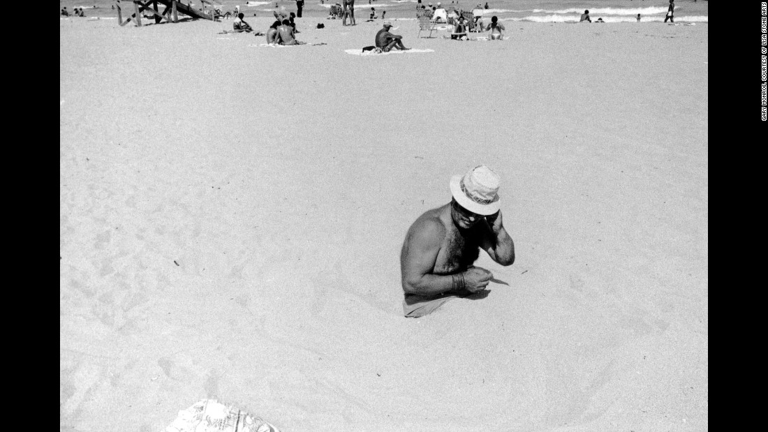 "A man sits in the sand at the Lummus Park beach in 1980. Although Monroe made thousands of prints, he selected only a few to include in his ""<a href=""http://www.lisastonearts.com/gallery-store.html"" target=""_blank"">Life in South Beach</a>"" photo book. ""For whatever reason, I choose 18 because in Hebrew, the expression (often a toast) means 'to life,' "" he said. ""And I wanted to underscore, no matter how subtly, that idea. These people faced the worst of humanity and still, in old age even, lived life fully, with zest and optimism."""