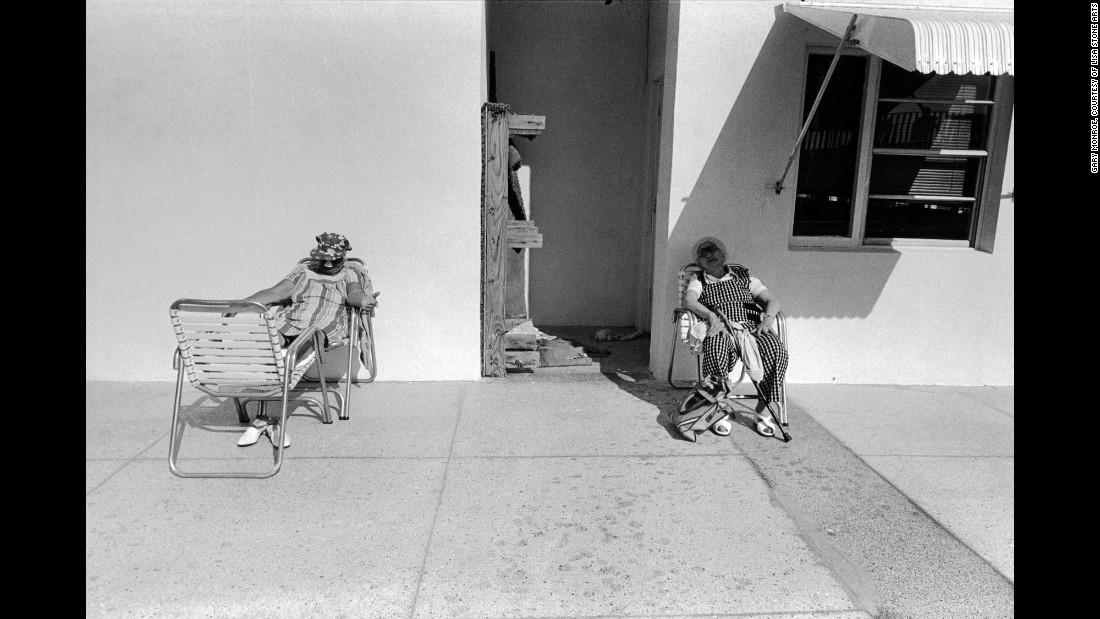 "Women sit poolside along Ocean Drive in 1979. Even after all these years, Monroe says friends, family and photography often take him back to South Beach. ""Suffice to say that I found the old South Beach way more interesting than it is today -- in every way,"" Monroe said. ""I was photographing there a couple weeks ago and noticed that the scores of outdoor cafes obscure the art deco architecture of the hotels lining Ocean Drive."""