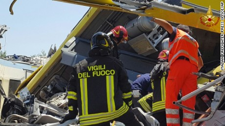 Firefighters inspect the wreckage of two trains after a head-on collision Tuesday in the Puglia region.