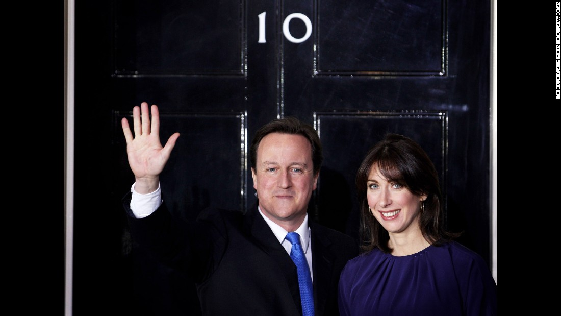Cameron and his wife Samantha wave on the steps of Downing Street on May 11, 2010 after he took office.