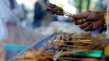 An Indonesian man prepares traditional foods for ''Buka Puasa'' to break the fast during the month of Ramadan in Denpasar on the resort island of Bali on August 2, 2011. Like millions of Muslim around the world, Indonesians celebrated the month of Ramadan by abstaining from eating, drinking, and smoking as well as sexual activities from dawn to dusk. AFP PHOTO/SONNY TUMBELAKA (Photo credit should read SONNY TUMBELAKA/AFP/Getty Images)