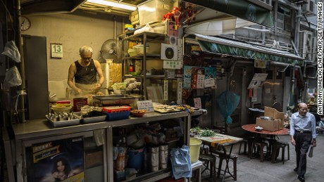 Dining at a dai pai dong, a no-fuss street restaurant, is an essential Hong Kong experience.