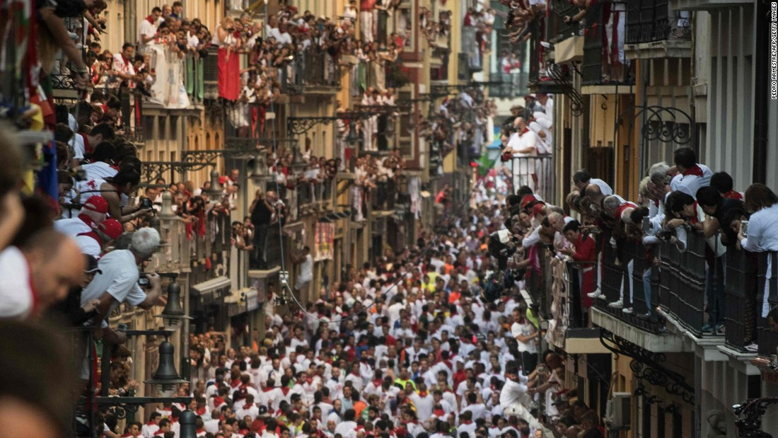 "Spectators watch from balconies during the annual ""running of the bulls."""