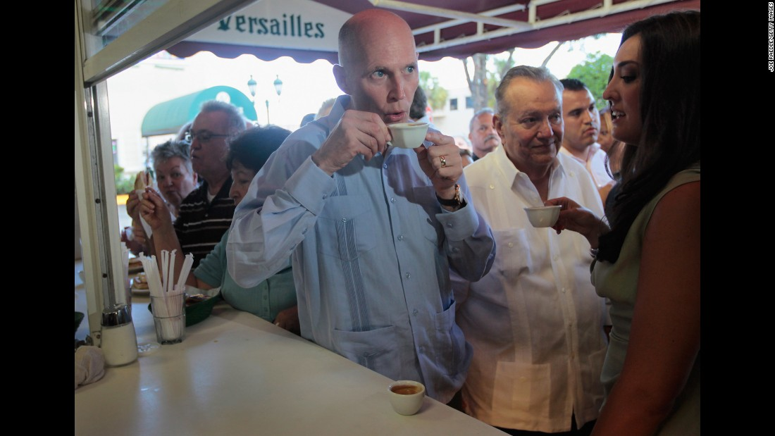 Florida Gov. Rick Scott drinks a Cuban coffee at Versailles Restaurant in Miami during a visit to celebrate the eatery's 40th anniversary in 2011. The restaurant is where U.S. presidents, governors and other politicians come to court the Cuban exile vote.